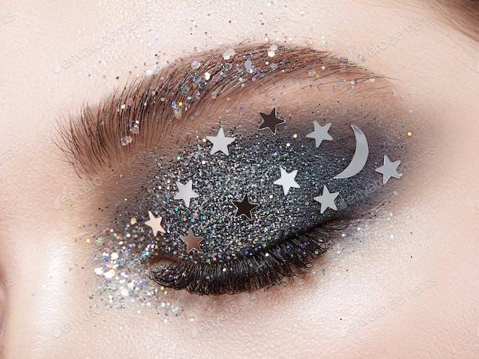 Eye makeup woman with decorative stars
