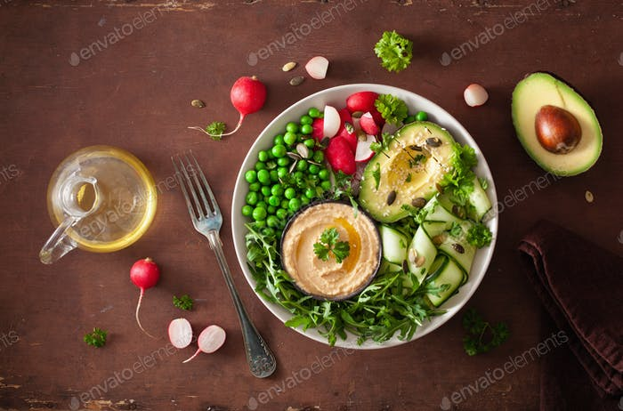 healthy vegan lunch bowl with avocaco cucumber hummus peas radis