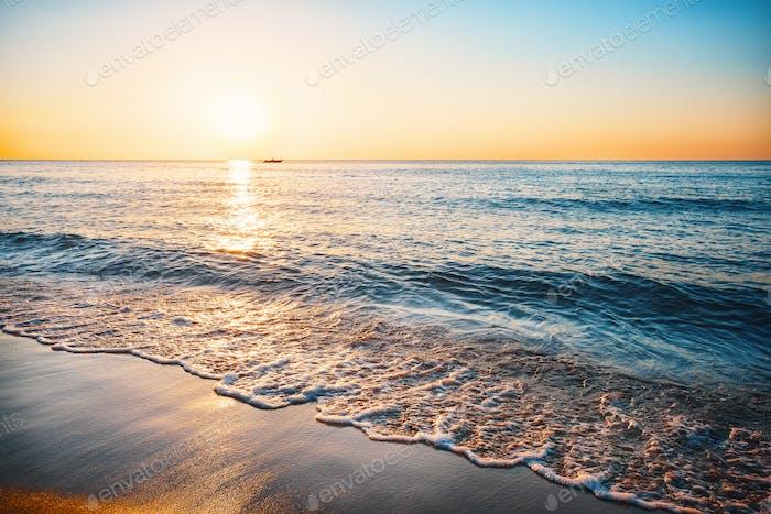 Sea sandy beach with surf