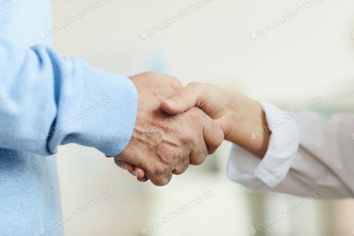 Unrecognizable Senior Man Shaking Hands with Doctor Close Up