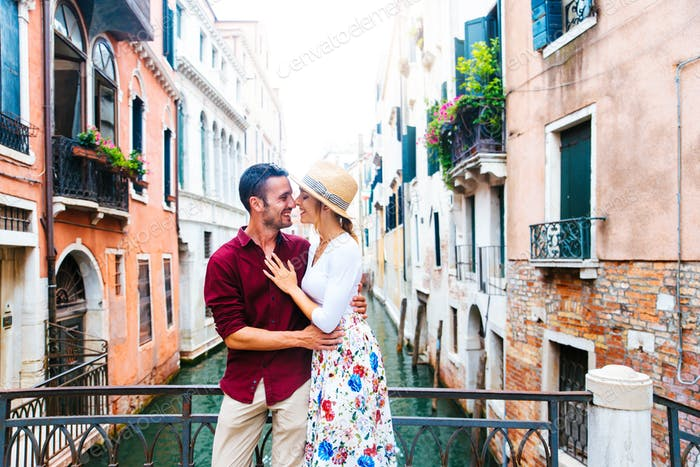 Romantic couple in love kissing in Venice, Italy