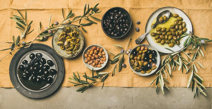 Flat-lay of mediterranean meze olives appetizers, wide composition