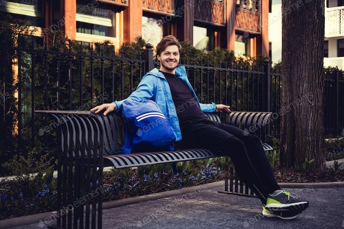 A man in a blue hoodie