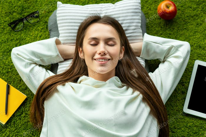 Woman closed eyes and resting during a break