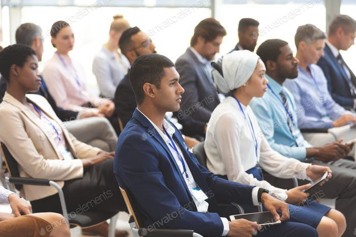 Side view of diverse business people attending a business seminar in office building
