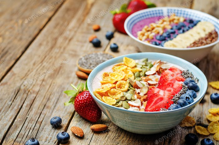Blueberries and strawberries healthy smoothies breakfast bowls w