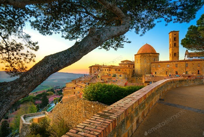 Tuscany, Volterra town skyline, church and trees on sunset. Ital