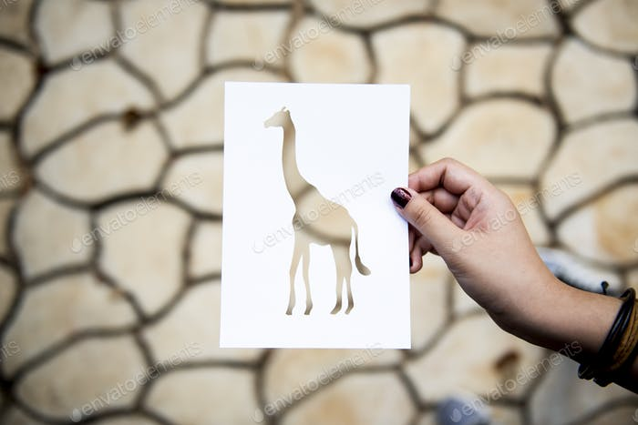 Hand Hold Giraffe Paper Carving with Cracked Background