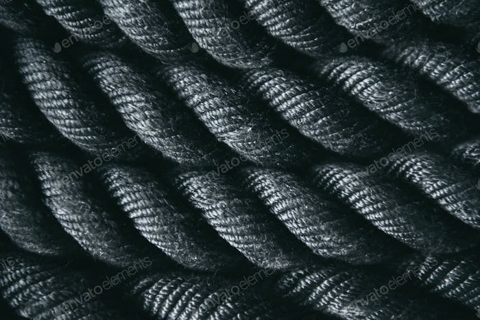 Close up of black battle rope for functional training. Sport and fitness equipment.