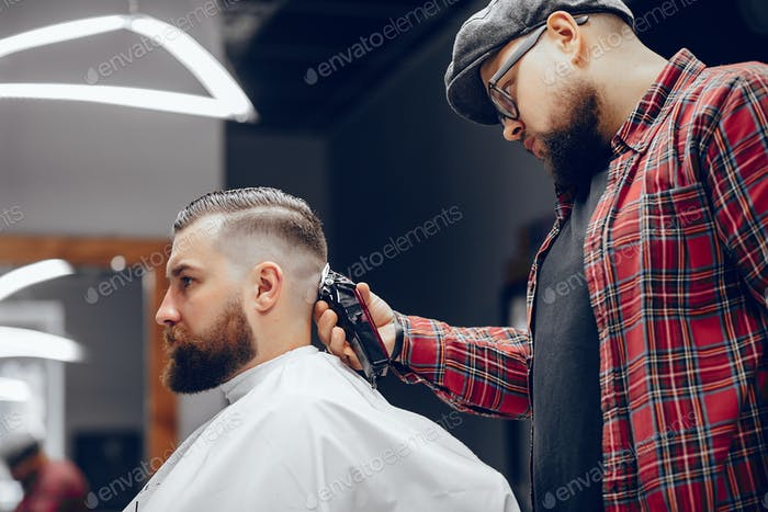 Stylish man sitting in a barbershop