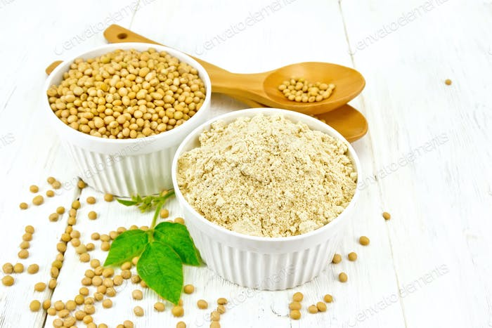 Flour soy with soybeans and leaf on board