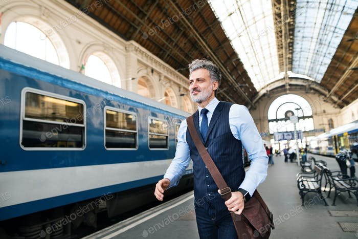 Mature businessman on a train station.