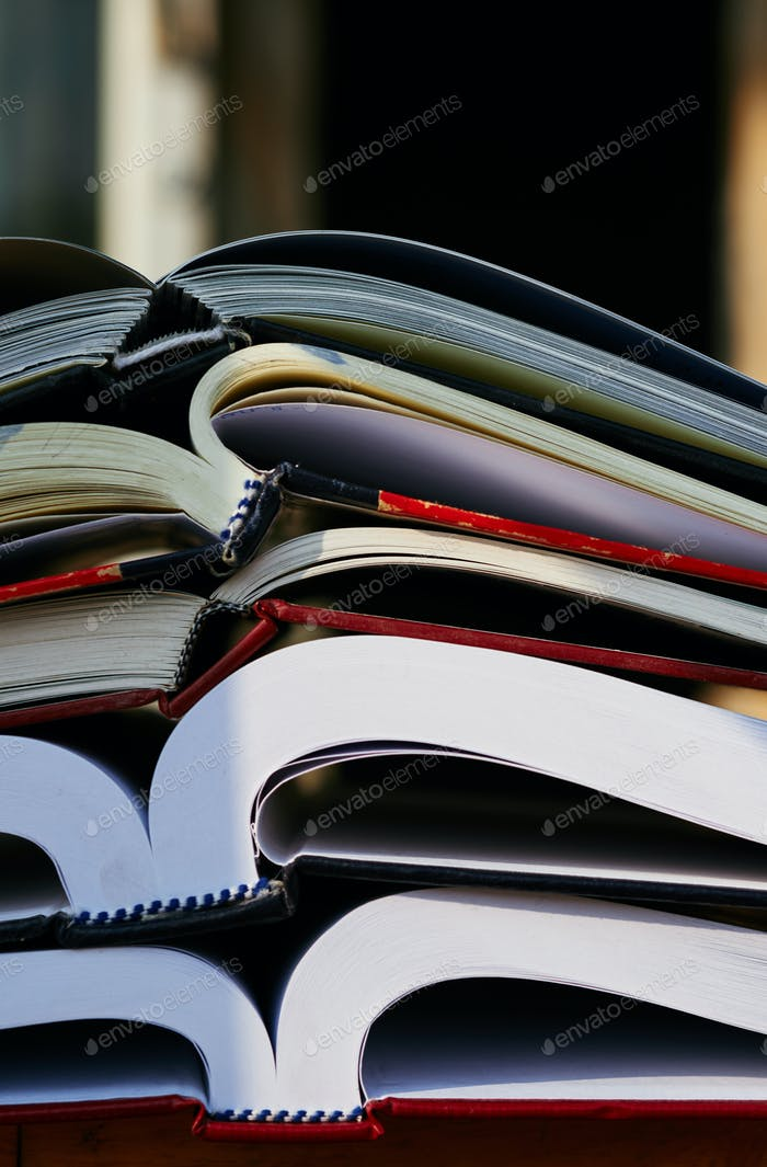 Close-up view of stacking books