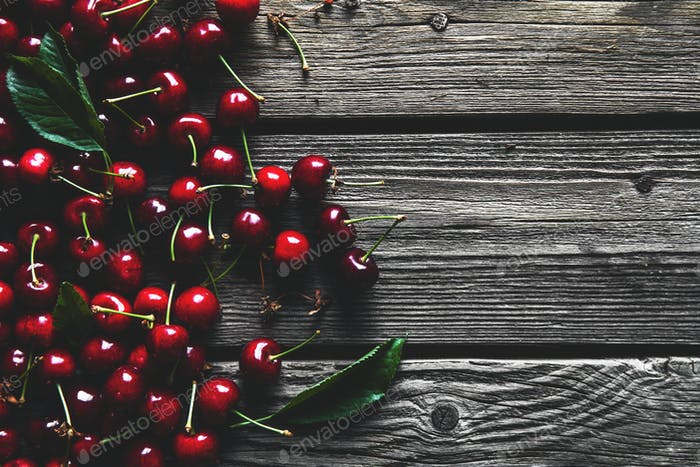 fresh cherries on wooden table, healthy food, fruit