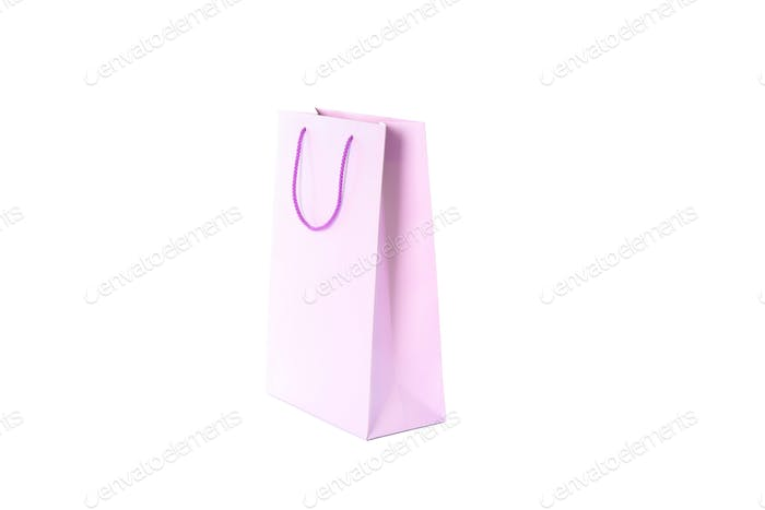 Purple paper bag isolated on white background
