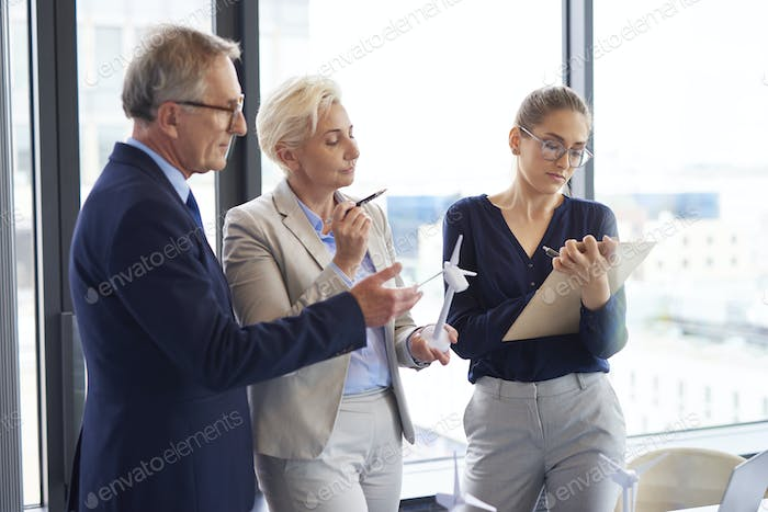Business talks about renewable energy in the office