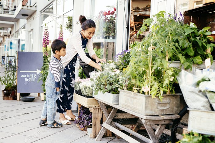 Mother with son (4-5) choosing plants