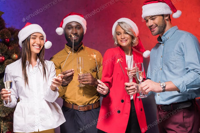 happy multicultural businesspeople celebrating at new year corporate party