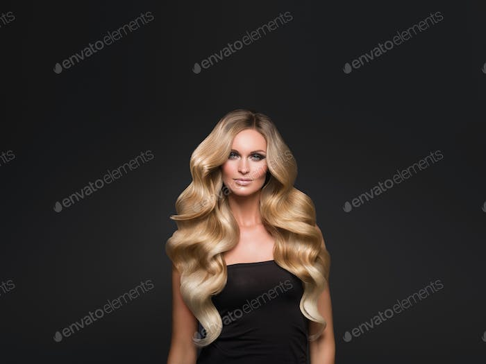 Blond woman long hair curly natural fashion makeup