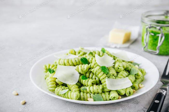 Fusilli pesto pasta with pine nuts, basil leaves and parmesan cheese