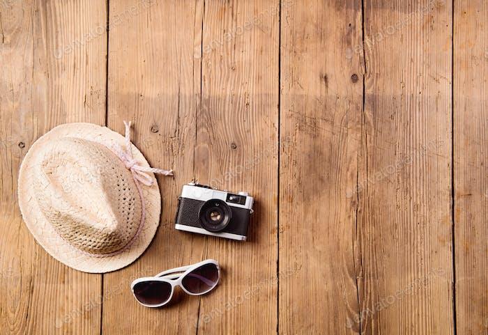 Summer vacation composition. Sunglasses, camera, hat. Studio sho