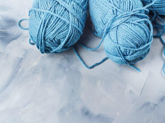 Blue wool knitting yarn on faded background