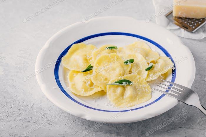 ravioli pasta with parmesan cheese and sage
