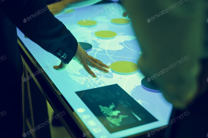 Hands point a cyber space diagram table in a meeting