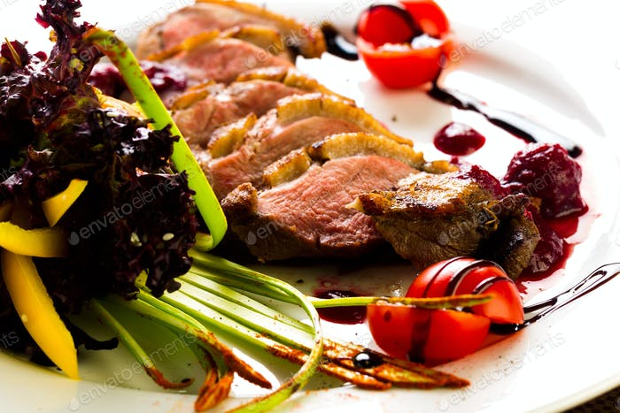 Duck baked with vegetables and herbs