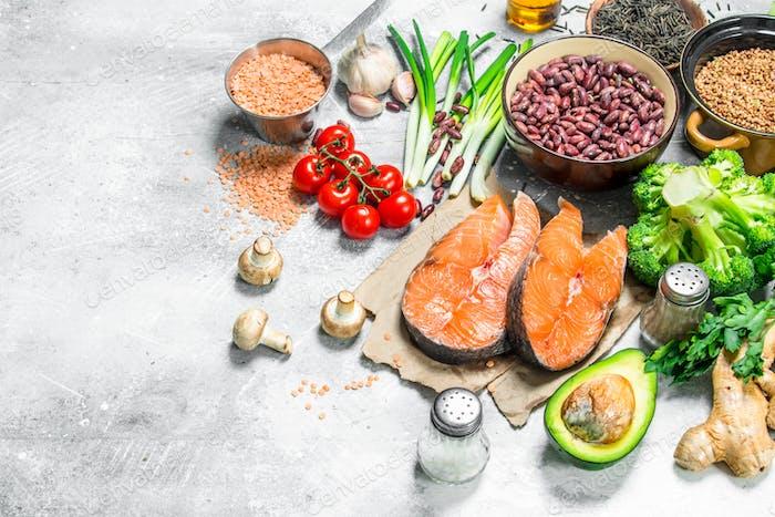 Organic food. Assortment of heathy food with raw salmon steaks .