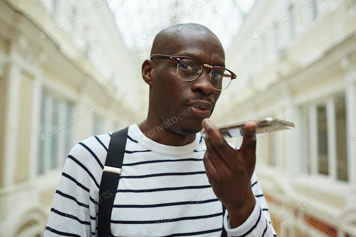 African Man Calling by Smartphone