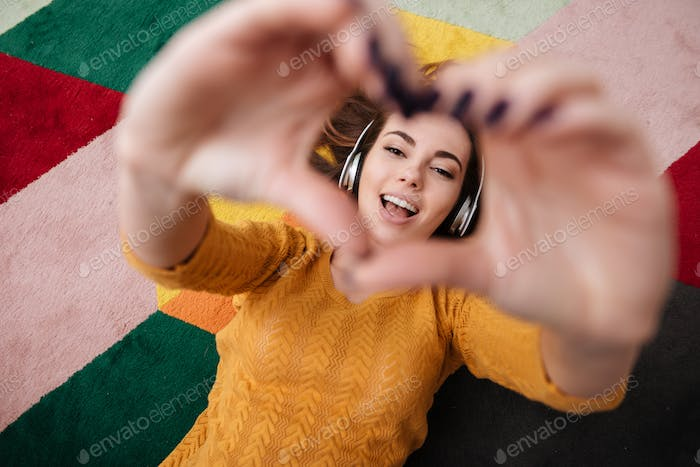 Portrait of a young pretty girl in headphones enjoying music