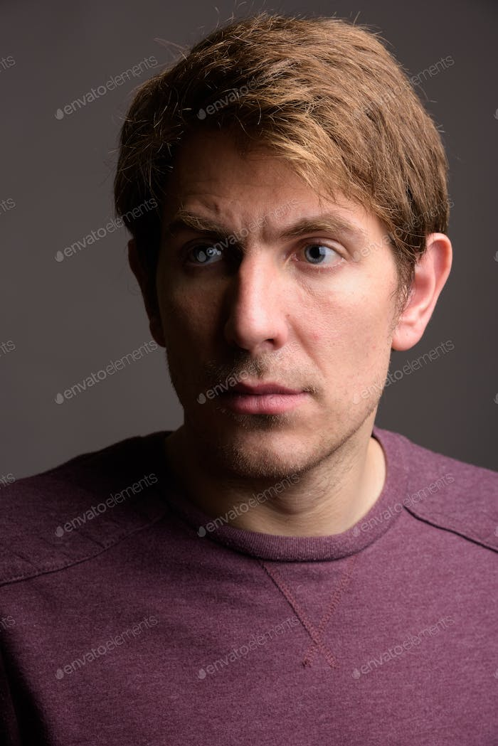 Portrait of handsome man against gray background