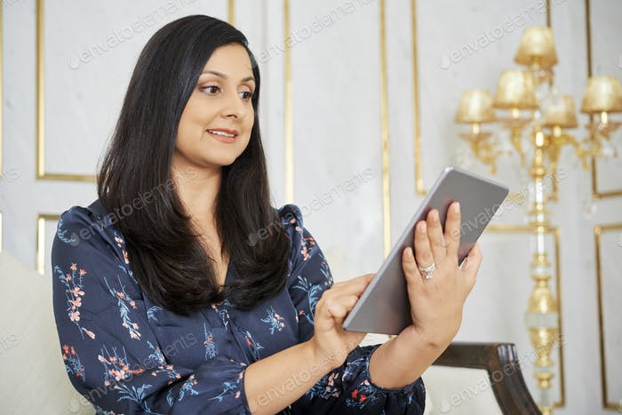 Woman working online on tablet pc