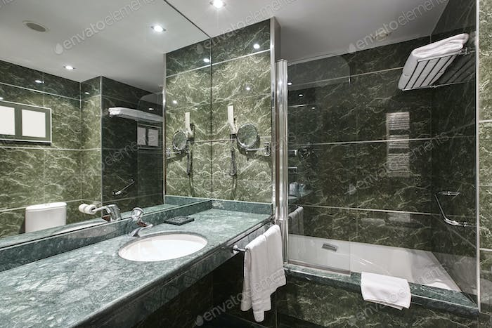 Luxury bathroom in green marble. Decoraton hotel home interior. Horizontal