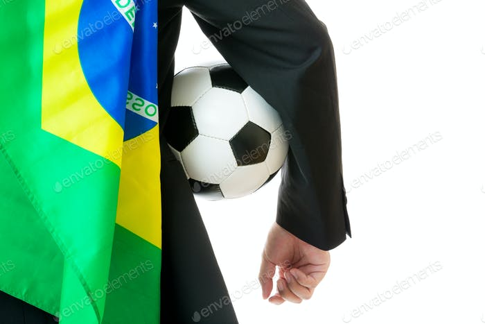 Supporter with brazil flag holding soccer ball