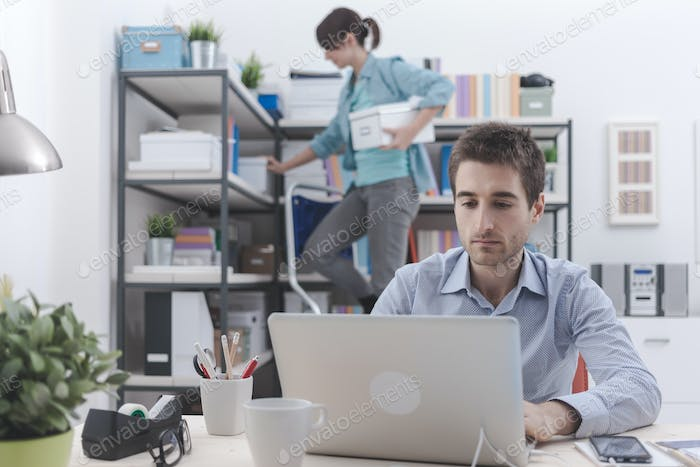Two people working in the office