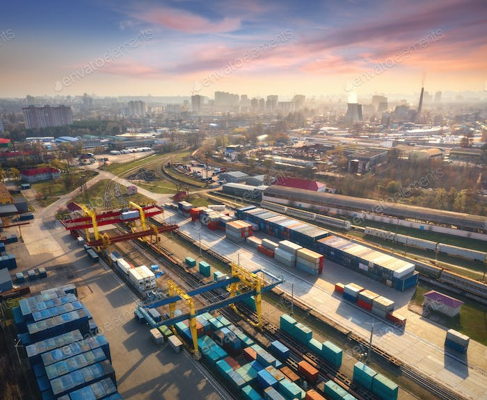 Aerial view of container loading and unloading at sunset