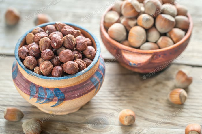 Rustic bowls of hazelnuts on the wooden table