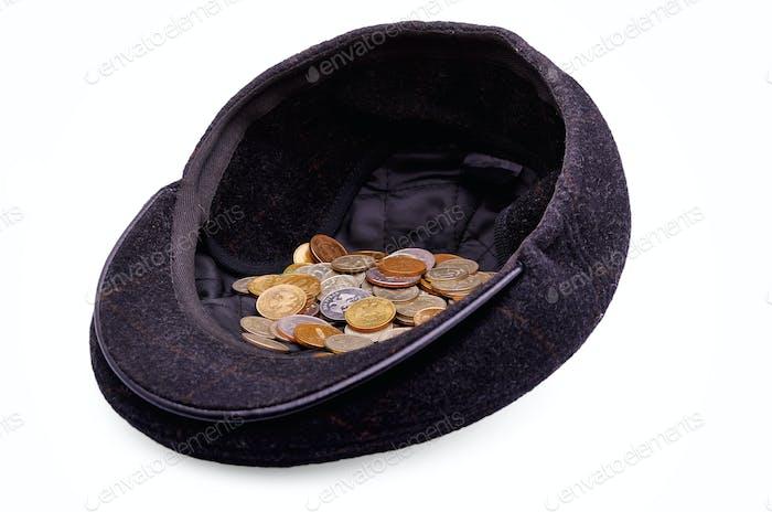 Monedas en una tapa