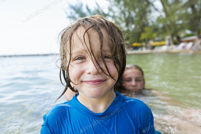 smiling 5 year old boy in the ocean