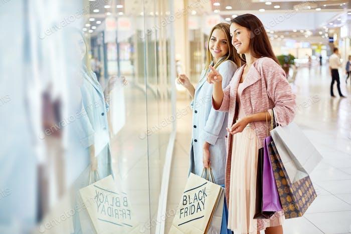 Young Women Window Shopping in Mall