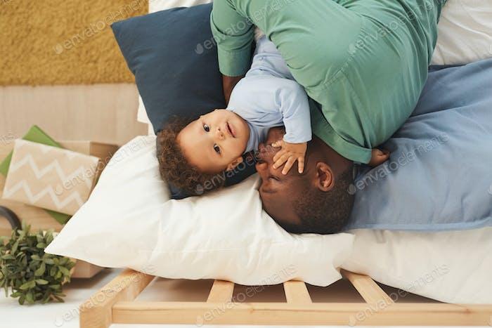 Man Sleeping with Baby Boy