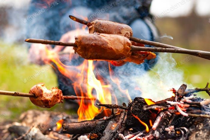 Close-up three sausages on a sticks