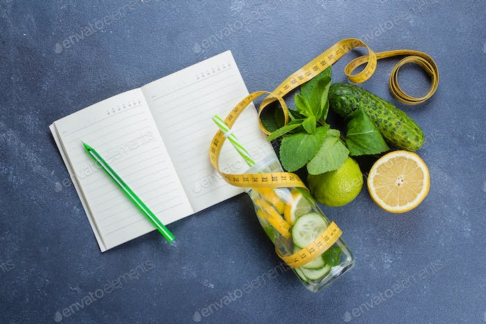 Healthy detox water with lime, lemon, cucumber and mint. Top view, copy space