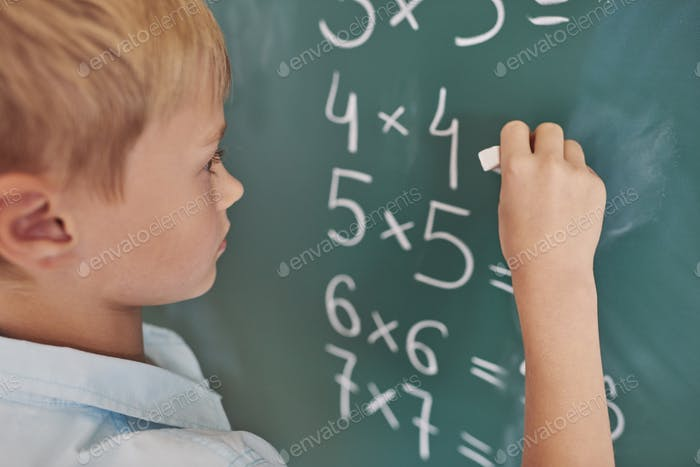 Boy doing some mathematical exercises