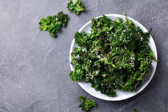 Kale Chips, Healthy Snack on a Plate. Grey Background. Close up. Copy Space.