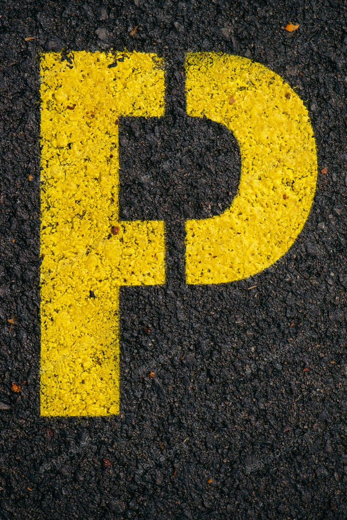 Letter P on asphalt road