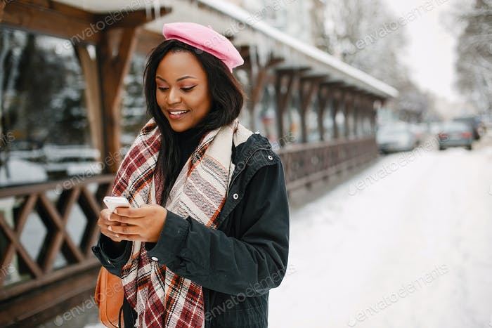 Elegant black girl in a winter city