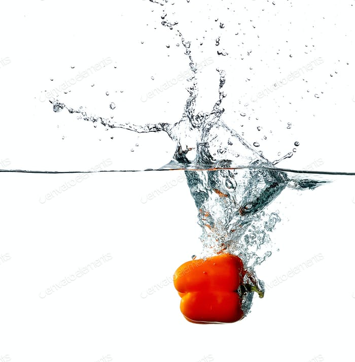 Pepper drops into a water